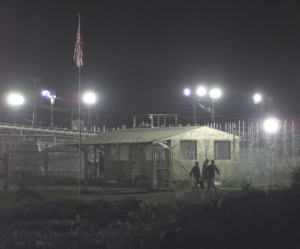 Guantanamo_captive_being_moved_at_night_in_camp_x-ray